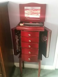 red wooden dresser with mirror