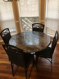 round brown wooden table with four chairs Loganville, 30052