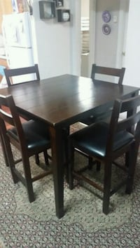 rectangular brown wooden table with six chairs din Surrey, V3W 0T9