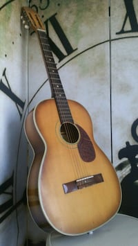 brown and black acoustic guitar Vancouver, V6A 1G5