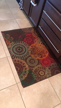 red, black, and white floral area rug Middleburg, 32068