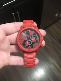 Round gold chronograph watch with red link bracelet Regina, S4N 1S8
