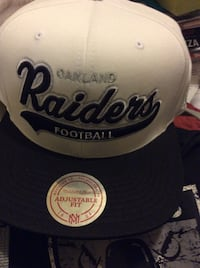 white and black Oakland Raiders football cap