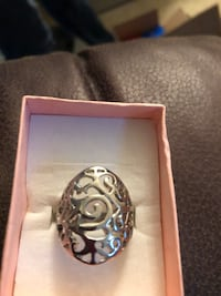 Silver-colored ring in box