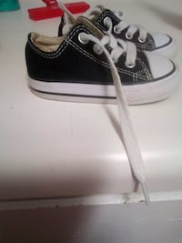 toddler's black-and-white Converse All-Star low-tops 542 mi