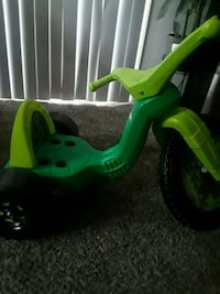 green and yellow ride-on toy
