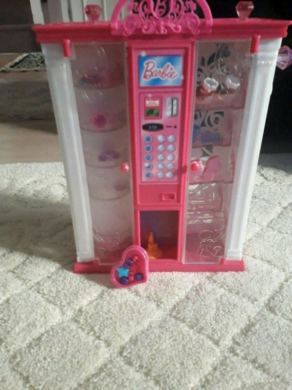 pink and white plastic doll house