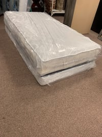 Twin white hm mattress in plastic with box spring Temple Hills