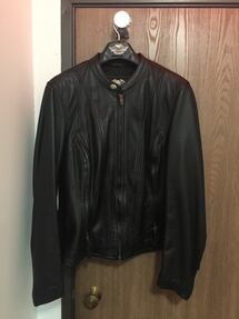 Like new. Harley Davidson black leather riding jacket. Women's xl.