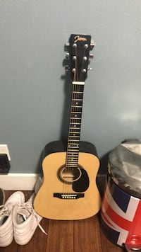 Brown and black acoustic guitar Bend, 97703