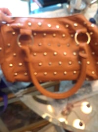 Camel colored handbag.