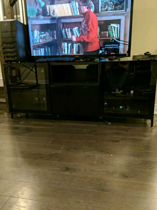 Media cabinet with intake and exhaust fans