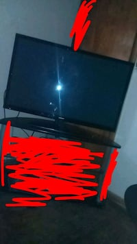 black flat screen TV with remote Tulsa, 74104
