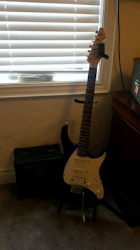 brown and white stratocaster electric guitar Vaughan, L4H 4L6