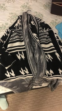 white and black knitted cardigan Québec, G1V 1T1