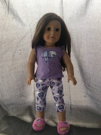 An american girl doll! Just one detour on the teeth but thats all! Barely used! Great deal! First iteam on here! (+comes with pajamas on !) still in box