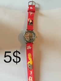 round silver analog watch with red strap