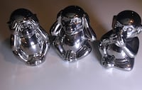 three stainless steel monkey figurines