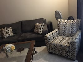 Brand new sofa and matching chair with pillows. Price**. FIRM