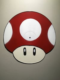 Mario mushroom cut out of a record  Dorval, H9P 2C9