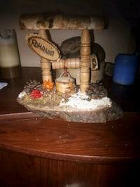 two brown wooden candle holders 791 km