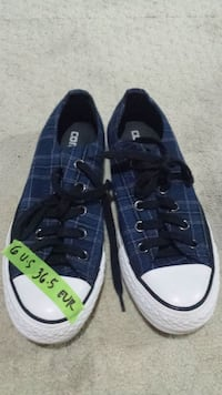pair of blue-and-white Converse low top sneakers