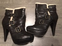 women's pair of brown leather buckled booties