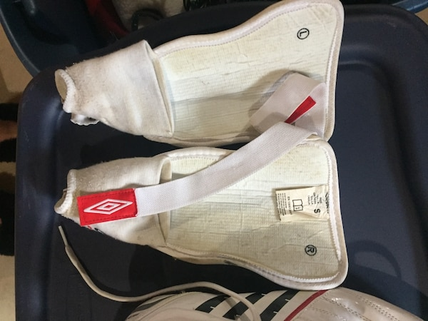 6e6c5dcc353 Used Ladies White and blue Umbro shin guards and pair of white-and ...
