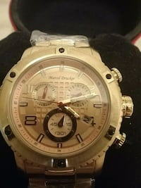 round gold-colored chronograph watch with link bracelet Waterloo, N2J 1K7