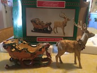 Golden accents sleigh by Lloyd. Christmas Grand Junction, 81503
