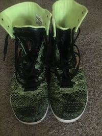 Pair of green-and-black nike basketball shoes Spanaway, 98387