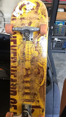 yellow and red skateboard