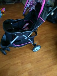 baby's black and pink jogging stroller 23 km