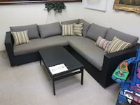 Sunbrella fabric patio sectional with table