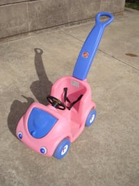 toddler's pink and purple Step2 ride-on toy
