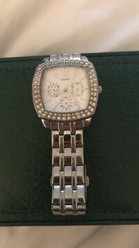 Round silver-colored chronograph watch with link bracelet North Vancouver, V7M 1V4