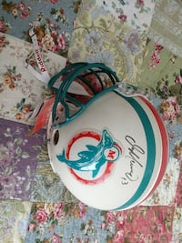 white and blue signed Miami Dolphins football helmet