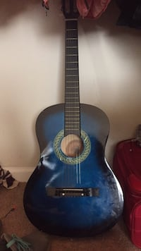 blue and black classical guitar