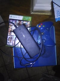 blue Xbox 360 with controller, Xbox 360 case, and adapter North Lauderdale, 33068