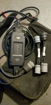 Cat comm adapter 3 with laptop and software Howell