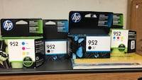 assorted HP ink cartridge boxes