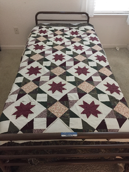 white, beige and maroon comforter