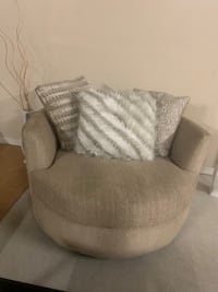 Cream swivel chair with fur pillow