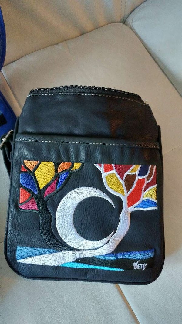 72f40a46671e Used black,white, and red leather bag for sale in Calgary - letgo