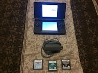 Blue Nintendo DS with 3 games