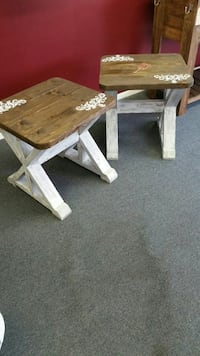two brown-and-white wooden side tables