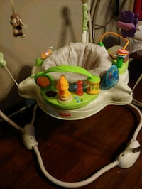 baby's white and green Fisher-Price jumperoo 163 mi
