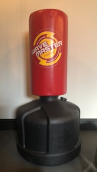 red and black Wave Master freestanding heavy bag 377 mi