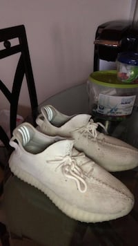 Pair of white adidas low top sneakers Toronto, M9W 7J5