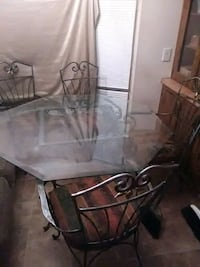 Havertys Glass table whth 4 wrought iron chairs  Murfreesboro, 37129
